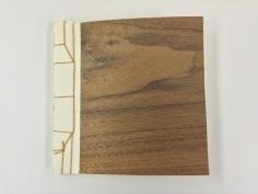 Book with wooden laminate